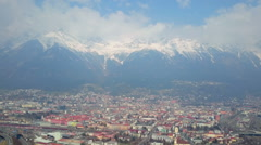 Winter panorama of beautiful European city and mountains covered with snow Stock Footage