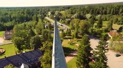 Old catholic church building. Aerial footage. Camera around - stock footage