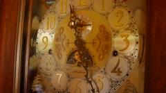 A cool old grandfather clock face in living room - stock footage
