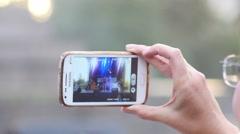 Spectator woman shooting concert performance via smart phone camera Stock Footage