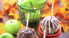 Hand dipped caramel apples decorated for Halloween. - stock footage