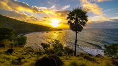 4K Timelapse. Sunset on the Jemeluk Beach with views of volcano Stock Footage