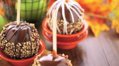 Hand dipped caramel apples decorated for Halloween. Stock Footage