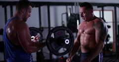 Two athletes working out together with heavy weights at a gym. Shot on RED Epic. Stock Footage