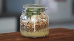 Cook's hands preparing vegetable salad - salad in a jar  Stock Footage