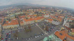 Aerial view of old city, central square, red roofs, gloomy mountains on horizon Stock Footage