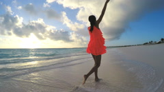 Young African American girl enjoying vacation on tropical beach - stock footage
