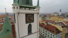 Aerial view of beautiful old clock on gothic city hall tower, historic landmark Stock Footage