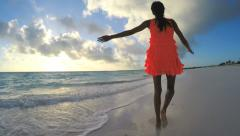African American female enjoying outdoor freedom on the beach Stock Footage