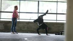 4K Two breakdancers take turns to windmill spin, shot on Red Epic Dragon Stock Footage