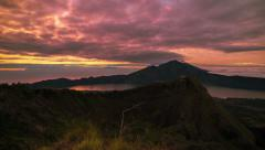 4K Timelapse. Sunrise on the volcano Batur overlooking Lake Batur Stock Footage