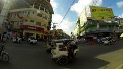 PUERTO PRINCESA - Tricycles crossing junction. 4K time lapse Stock Footage