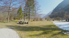 Off-season at resort, mountains, no tourists, empty playground, melting snow Stock Footage