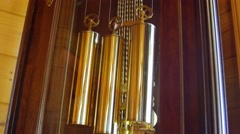 A cool old grandfather clock pendulum in living room Stock Footage