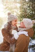 Couple under snowfall - stock photo