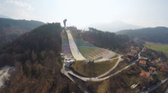 Empty modern Bergisel ski jump training center during low season, no people Stock Footage
