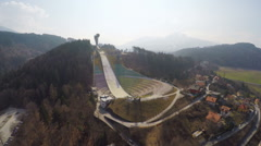 Aerial view of Austrian Bergisel ski jump training center, Olympics, off-season Stock Footage
