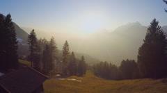 Magic hour sunrise in wonderland, mountain silhouettes in golden sunrays, beauty Stock Footage