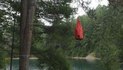Camping foodbag hung from tree to protect food from animals. Stock Footage