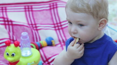 Baby with cookies and milk Stock Footage