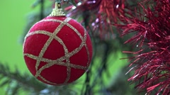 4K Closeup red ball decorative hang pine Christmas ornament indoor house family  Stock Footage