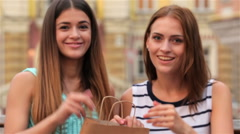 Shopaholic girlfriend show the thumbs up - stock footage