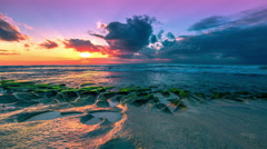 4K Timelapse. Sunset in the Indian Ocean on the Balangan beach volcanic bowls Stock Footage