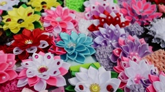 Many different hairpins in the form of artificial flowers. Stock Footage