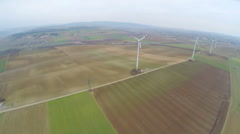 Wind turbines spinning on beautiful green fields, countryside. Renewable energy Stock Footage