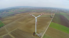 Stock Video Footage of Top view of rotating wind turbines. Industrial wind power. Alternative energy