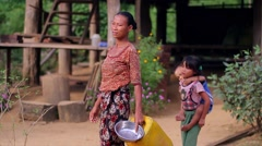 Mother with children goes through the village. Stock Footage