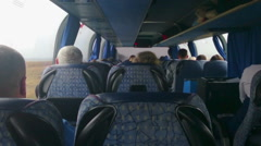 Tourist bus full of passengers. People traveling on a budget, in economy class Stock Footage