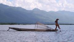 Rowing and paddling boat with leg Inle Lake Burma Myanmar Stock Footage
