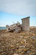 Abandoned ship on the shore in Svalbard - stock photo