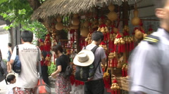 Chinese tourists, hand-crafted souvenirs - stock footage