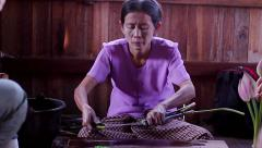 Filaments of the lotus hand made worker Burma Myanmar Stock Footage