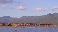 Men rowing oars on a wooden canoe Burma Myanmar - stock footage