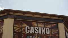 Cheap casino entrance sign - stock footage