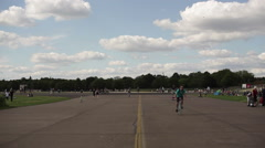 Abandoned Berlin Tempelhof Airport park, people on a sunny day Stock Footage