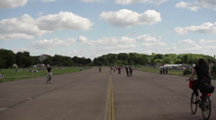 People on runway on a sunny day, Berlin Tempelhof abandoned Airport Stock Footage