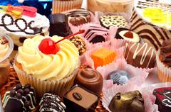 Chocolate sweets, muffins and cakes Stock Photos