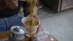 Eating noodles with chopsticks, China Stock Footage
