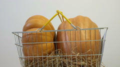 Pumpkins in basket Stock Footage