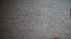 Blood splatting onto carpet Stock Footage
