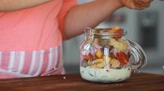 Cook's hands preparing vegetable salad - tomatoes  Stock Footage