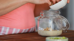 Cook's hands preparing vegetable salad - hummus Stock Footage