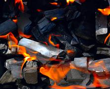 Burning coal for a barbecue - stock photo