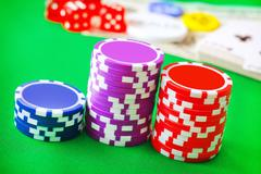 Group from chips for poker on the green background Stock Photos