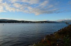 blue fjord and sun over tromsoe city island in late autumn - stock photo