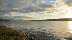 Blue fjord, autumn sunshine over tromsoe city island and mainland timelapse Stock Footage